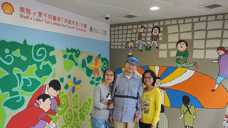 Mak Gor and his family took photo in front of two murals painted by Mak Gor, which represent public perception of an ideal future.