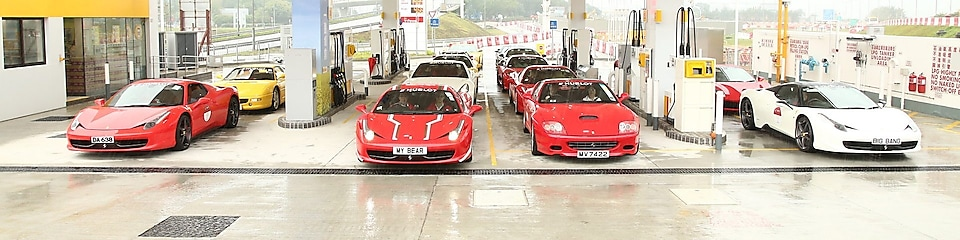 Ferraries parked at Shell gas station