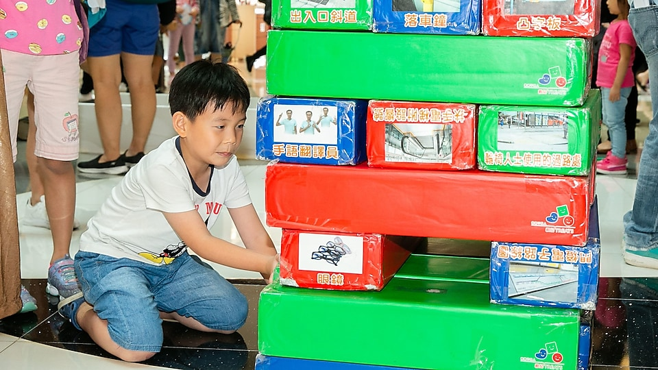 kids playing on game booth